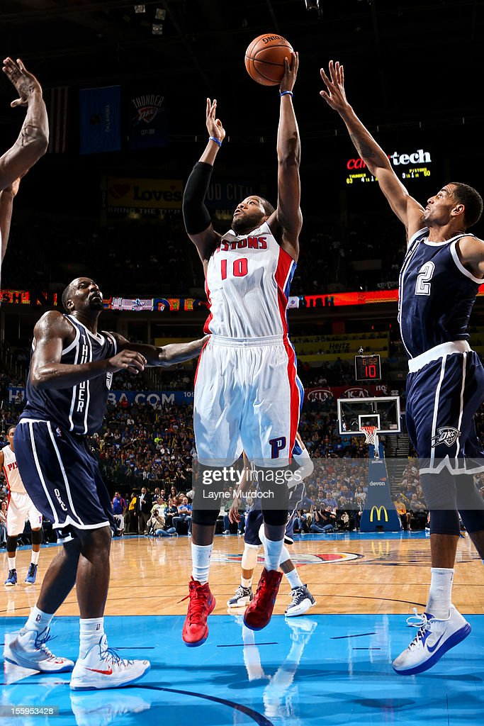 <a gi-track='captionPersonalityLinkClicked' href=/galleries/search?phrase=Greg+Monroe&family=editorial&specificpeople=5042440 ng-click='$event.stopPropagation()'>Greg Monroe</a> #10 of the Detroit Pistons shoots against <a gi-track='captionPersonalityLinkClicked' href=/galleries/search?phrase=Thabo+Sefolosha&family=editorial&specificpeople=587449 ng-click='$event.stopPropagation()'>Thabo Sefolosha</a> #2 and <a gi-track='captionPersonalityLinkClicked' href=/galleries/search?phrase=Kendrick+Perkins&family=editorial&specificpeople=211461 ng-click='$event.stopPropagation()'>Kendrick Perkins</a> #5 of the Oklahoma City Thunder on November 9, 2012 at the Chesapeake Energy Arena in Oklahoma City, Oklahoma.
