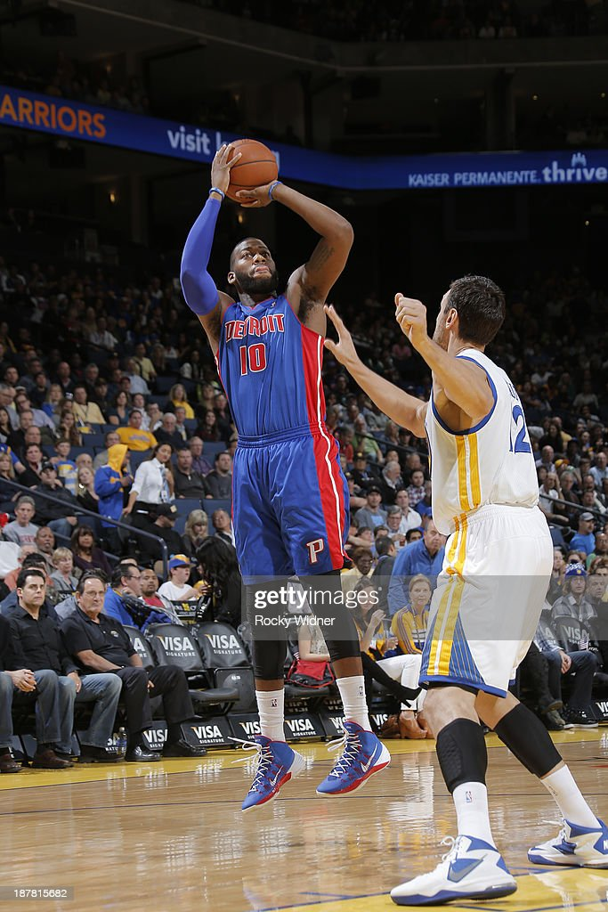 Greg Monroe #10 of the Detroit Pistons shoots against the Golden State Warriors on November 12, 2013 at Oracle Arena in Oakland, California.