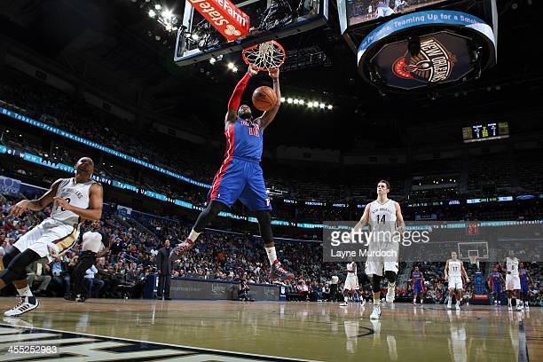 Greg Monroe of the Detroit Pistons shoots dunks the ball against the New Orleans Pelicans during an NBA game on December 11 2013 at the New Orleans...
