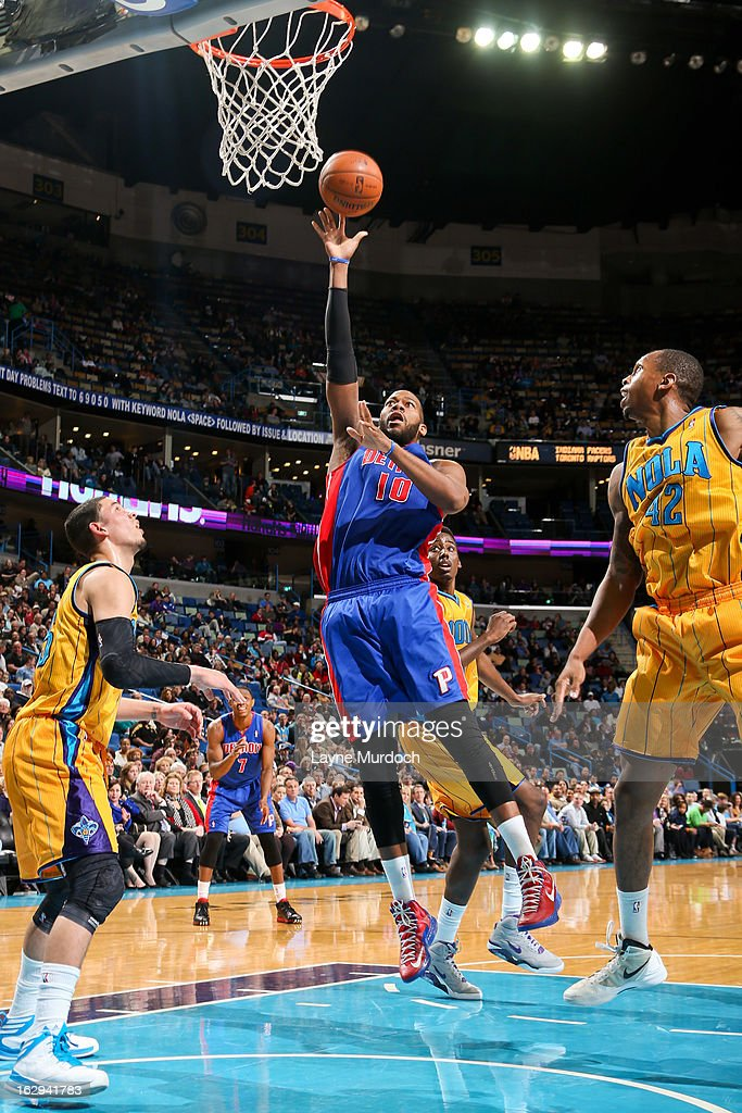 Greg Monroe #10 of the Detroit Pistons shoots in the lane against Lance Thomas #42 of the New Orleans Hornets on March 1, 2013 at the New Orleans Arena in New Orleans, Louisiana.