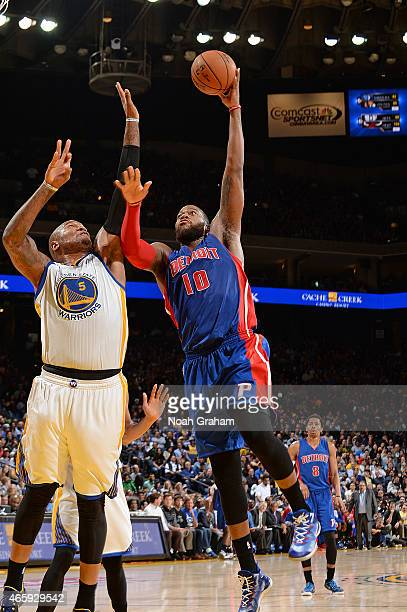 Greg Monroe of the Detroit Pistons shoots the ball against the Golden State Warriors on March 11 2015 at Oracle Arena in Oakland California NOTE TO...