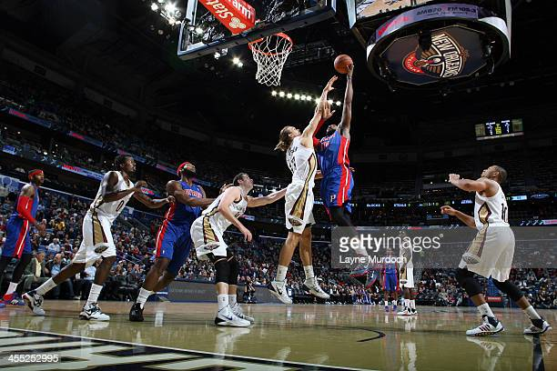 Greg Monroe of the Detroit Pistons shoots the ball against the New Orleans Pelicans during an NBA game on December 11 2013 at the New Orleans Arena...