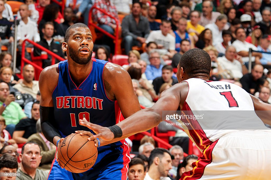 Greg Monroe #10 of the Detroit Pistons squares to shoot against Chris Bosh #1 of the Miami Heat on January 25, 2013 at American Airlines Arena in Miami, Florida.