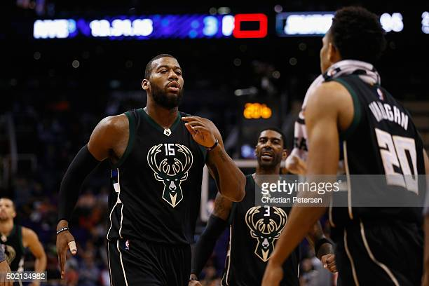 Greg Monroe of the Milwaukee Bucks celebrates with OJ Mayo and Rashad Vaughn after scoring against the Phoenix Suns during the second half of the NBA...