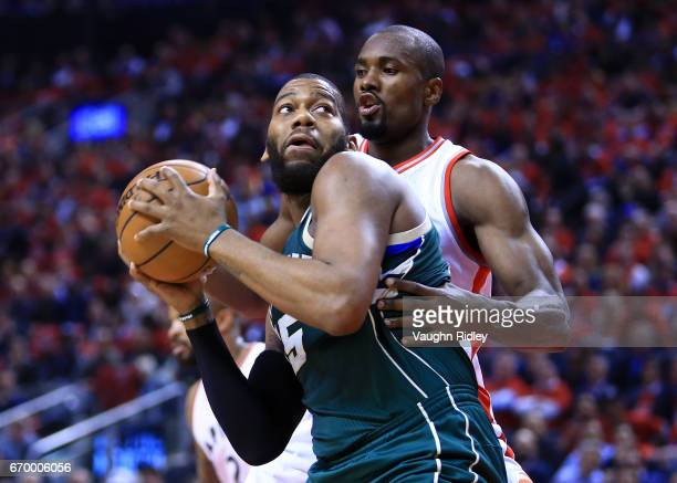 Greg Monroe of the Milwaukee Bucks controls the ball as Serge Ibaka of the Toronto Raptors defends in the first half of Game Two of the Eastern...