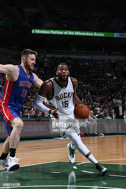 Greg Monroe of the Milwaukee Bucks drives to the basket against Aron Baynes of the Detroit Pistons on November 23 2015 at the BMO Harris Bradley...