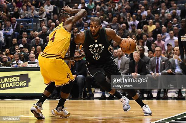 Greg Monroe of the Milwaukee Bucks drives to the basket against Iman Shumpert of the Cleveland Cavaliers during a game at BMO Harris Bradley Center...
