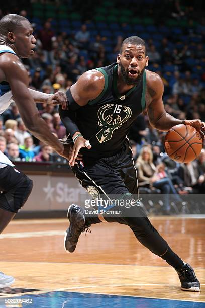 Greg Monroe of the Milwaukee Bucks drives to the basket against the Minnesota Timberwolves on January 2 2016 at Target Center in Minneapolis...