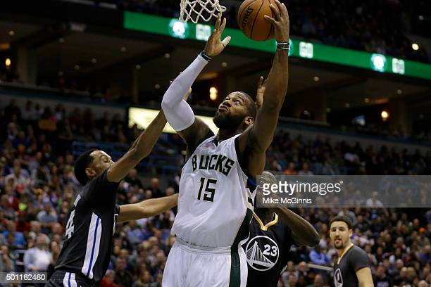 Greg Monroe of the Milwaukee Bucks drives to the hoop for two points during the fourth quarter against the Golden State Warriors at BMO Harris...