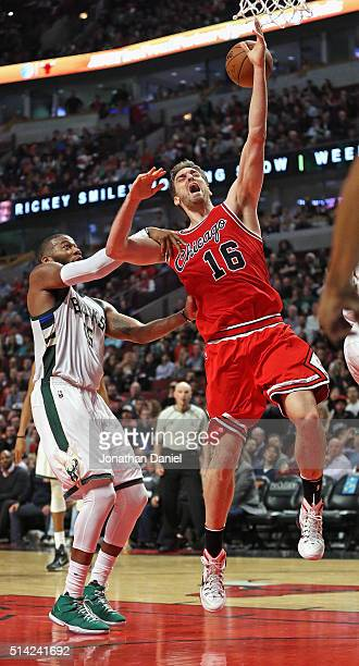 Greg Monroe of the Milwaukee Bucks fouls Pau Gasol of the Chicago Bulls at the United Center on March 7 2016 in Chicago Illinois The Bulls defeated...