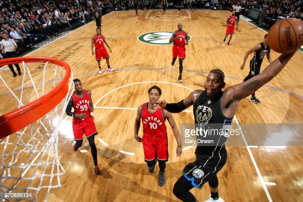 Greg Monroe of the Milwaukee Bucks goes to the basket against the Toronto Raptors during Game Three of the Eastern Conference Quarterfinals of the...