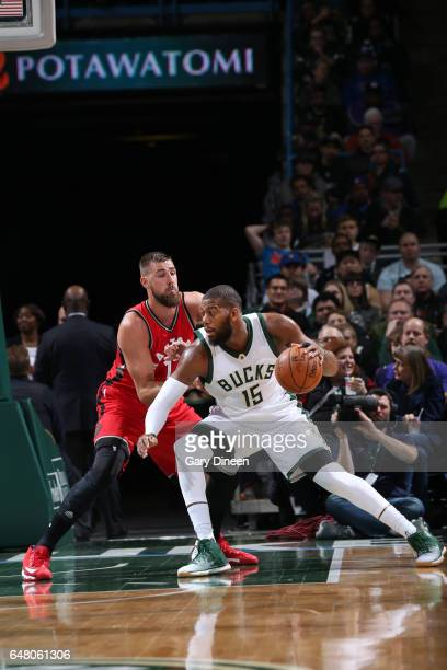 Greg Monroe of the Milwaukee Bucks handles the ball against Jonas Valanciunas of the Toronto Raptors during a game on March 4 2017 at BMO Harris...