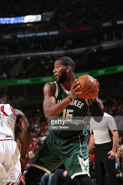Greg Monroe of the Milwaukee Bucks handles the ball against the Chicago Bulls during a preseason game on October 6 2015 at the United Center in...