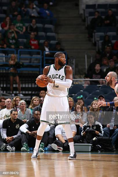 Greg Monroe of the Milwaukee Bucks handles the ball against the Washington Wizards during a preseason game on October 17 2015 at the BMO Harris...