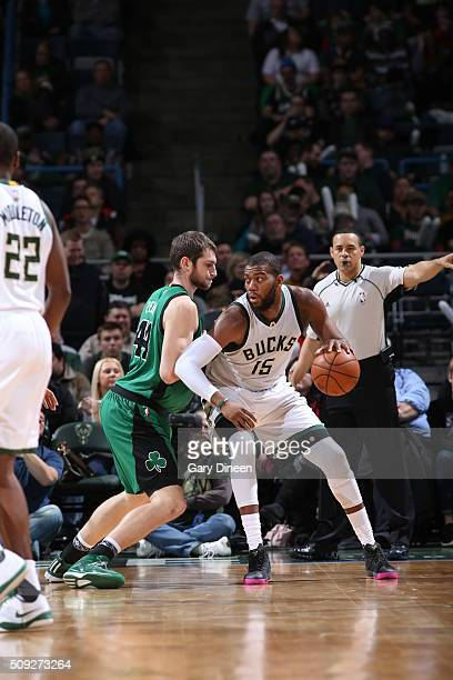 Greg Monroe of the Milwaukee Bucks handles the ball against Tyler Zeller of the Boston Celtics on February 9 2016 at the BMO Harris Bradley Center in...