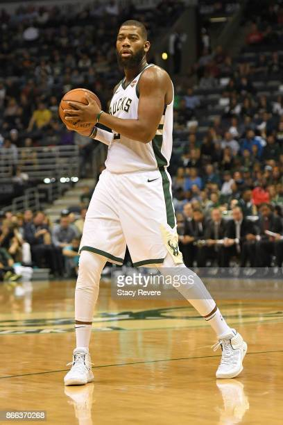 Greg Monroe of the Milwaukee Bucks handles the ball during a game against the Charlotte Hornets at the BMO Harris Bradley Center on October 23 2017...