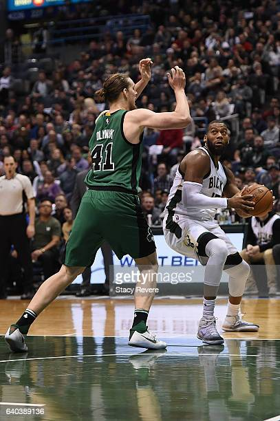 Greg Monroe of the Milwaukee Bucks is defended by Kelly Olynyk of the Boston Celtics during a game at the BMO Harris Bradley Center on January 28...