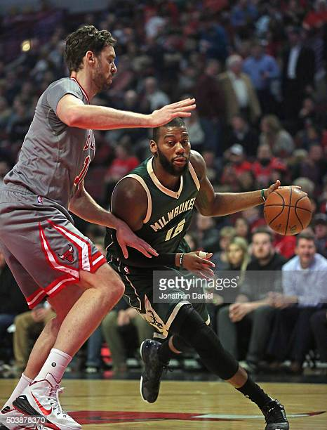 Greg Monroe of the Milwaukee Bucks moves against Pau Gasol of the Chicago Bulls at the United Center on January 5 2016 in Chicago Illinois The Bulls...