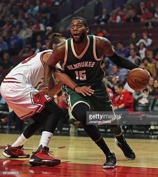 Greg Monroe of the Milwaukee Bucks moves around Joakim Noah of the Chicago Bulls during a preseason game at the United Center on October 6 2015 in...