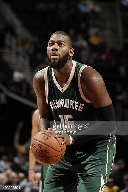 Greg Monroe of the Milwaukee Bucks prepares to shoot a free throw against the Cleveland Cavaliers on October 13 2015 at Quicken Loans Arena in...