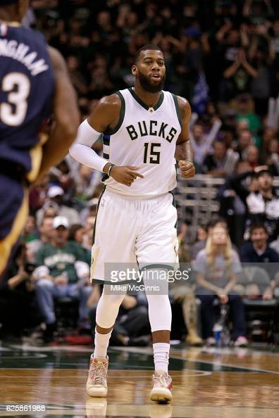 Greg Monroe of the Milwaukee Bucks runs down the court after making a basket during the game against the Indiana Pacers at BMO Harris Bradley Center...