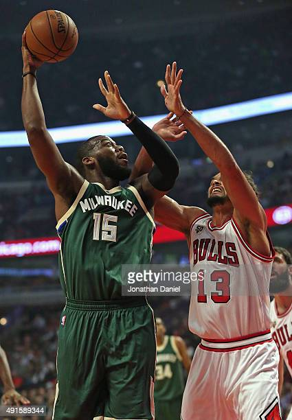 Greg Monroe of the Milwaukee Bucks shoots over Joakim Noah of the Chicago Bulls during a preseason game at the United Center on October 6 2015 in...