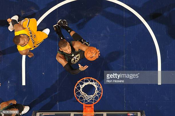 Greg Monroe of the Milwaukee Bucks shoots the ball against the Indiana Pacers on December 31 2015 at Bankers Life Fieldhouse in Indianapolis Indiana...