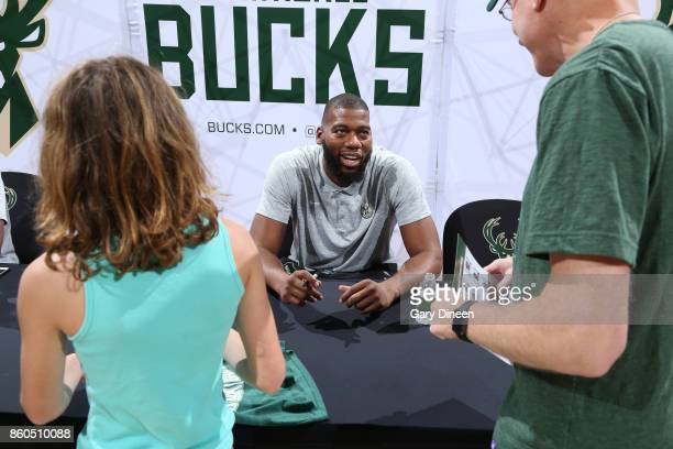 Greg Monroe of the Milwaukee Bucks signs autographs during the 5th Annual Milwaukee Bucks Fan Fest on October 8 2017 at the BMO Harris Bradley Center...