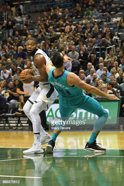 Greg Monroe of the Milwaukee Bucks works against Frank Kaminsky of the Charlotte Hornets during a game at the BMO Harris Bradley Center on October 23...