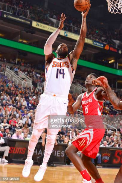 Greg Monroe of the Phoenix Suns dunks against Clint Cappella of the Houston Rockets on November 16 2017 at Talking Stick Resort Arena in Phoenix...