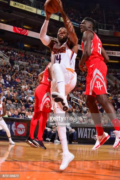 Greg Monroe of the Phoenix Suns grabs the rebound against the Houston Rockets on November 16 2017 at Talking Stick Resort Arena in Phoenix Arizona...