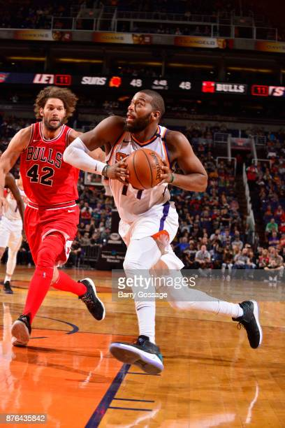 Greg Monroe of the Phoenix Suns handles the ball against Robin Lopez of the Chicago Bulls on November 19 2017 at Talking Stick Resort Arena in...