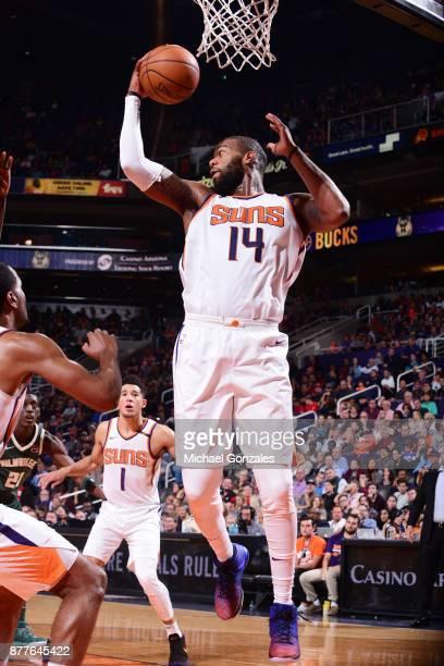 Greg Monroe of the Phoenix Suns handles the ball against the Milwaukee Bucks on November 22 2017 at Talking Stick Resort Arena in Phoenix Arizona...