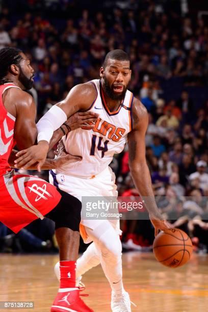 Greg Monroe of the Phoenix Suns handles the ball against the Houston Rockets on November 16 2017 at Talking Stick Resort Arena in Phoenix Arizona...