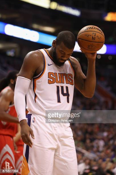 Greg Monroe of the Phoenix Suns reacts during the first half of the NBA game against the Houston Rockets at Talking Stick Resort Arena on November 16...