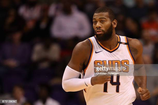 Greg Monroe of the Phoenix Suns runs upcourt during the first half of the NBA game against the Houston Rockets at Talking Stick Resort Arena on...