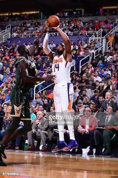 Greg Monroe of the Phoenix Suns shoots the ball against the Milwaukee Bucks on November 22 2017 at Talking Stick Resort Arena in Phoenix Arizona NOTE...