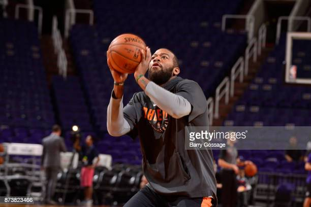 Greg Monroe of the Phoenix Suns warms up before the game against the Los Angeles Lakers on November 13 2017 at Talking Stick Resort Arena in Phoenix...