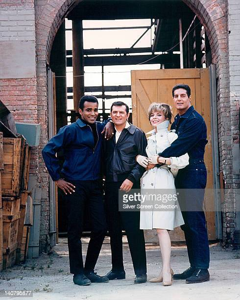 Greg Morris US actor Steven Hill US actor Barbara Bain US actress and Peter Lupus US actor and bodybuilder pose for a group portrait on the set of...