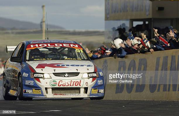 Greg Murphy of the KMart Racing Team crosses the line to win the Bob Jane Bathurst 1000 which is round 10 of the V8 Supercar Championship October 12...