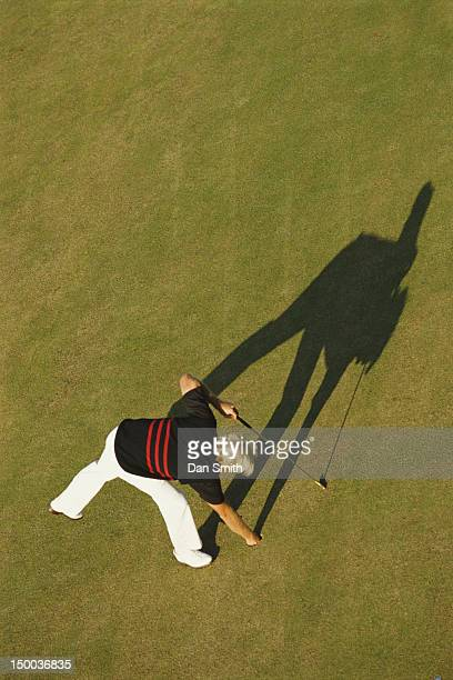 Greg Norman of Australia and his shadow stretch over the 6th hole during the 119th British Open Championship held on 21st July 1990 at The Old Course...
