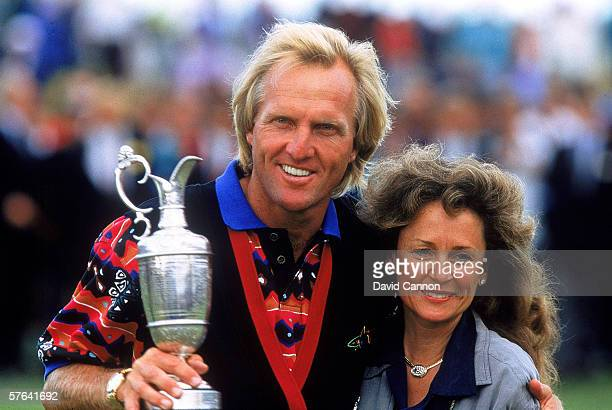 Greg Norman of Australia celebrates with his wife after winning the British Open at Royal St Georges in Sandwich Kent England on July 18 1993