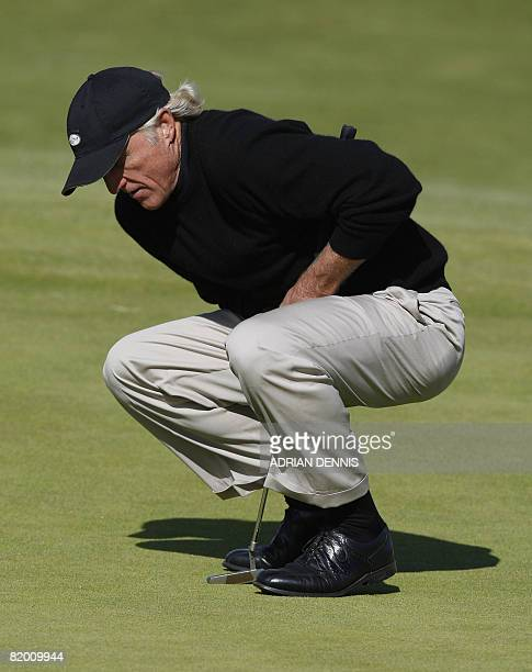 Greg Norman of Australia gestures as he putts on the 10th green during the fourth round at The Open golf tournament at Royal Birkdale in Southport in...