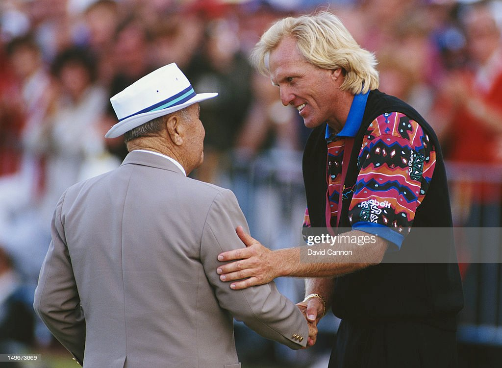 <a gi-track='captionPersonalityLinkClicked' href=/galleries/search?phrase=Greg+Norman&family=editorial&specificpeople=201538 ng-click='$event.stopPropagation()'>Greg Norman</a> of Australia is congratulated by <a gi-track='captionPersonalityLinkClicked' href=/galleries/search?phrase=Gene+Sarazen&family=editorial&specificpeople=890883 ng-click='$event.stopPropagation()'>Gene Sarazen</a> after winning the 122nd Open Championship on 18th July 1993 at the Royal St George's Golf Club in Sandwich, United Kingdom.