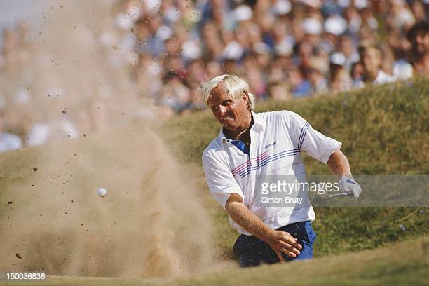 Greg Norman of Australia plays a shot from the bunker during the 118th British Open Golf Championship on 22nd July 1989 at the Royal Troon Golf Club...
