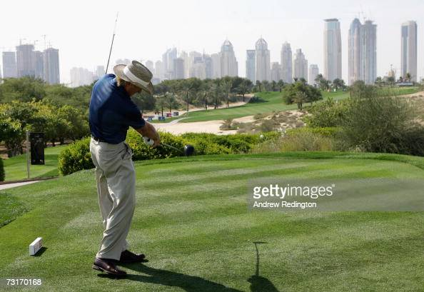 Greg Norman of Australia tees off on the eighth hole during the first round of the Dubai Desert Classic on the Majilis Course at Emirates Golf Club...