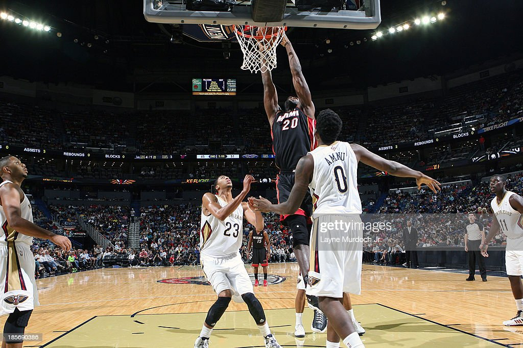 <a gi-track='captionPersonalityLinkClicked' href=/galleries/search?phrase=Greg+Oden&family=editorial&specificpeople=812113 ng-click='$event.stopPropagation()'>Greg Oden</a> #20 of the Miami Heat dunks the ball against the New Orleans Pelicans during an NBA preseason game on October 23,2013 at the New Orleans Arena in New Orleans, Louisiana.