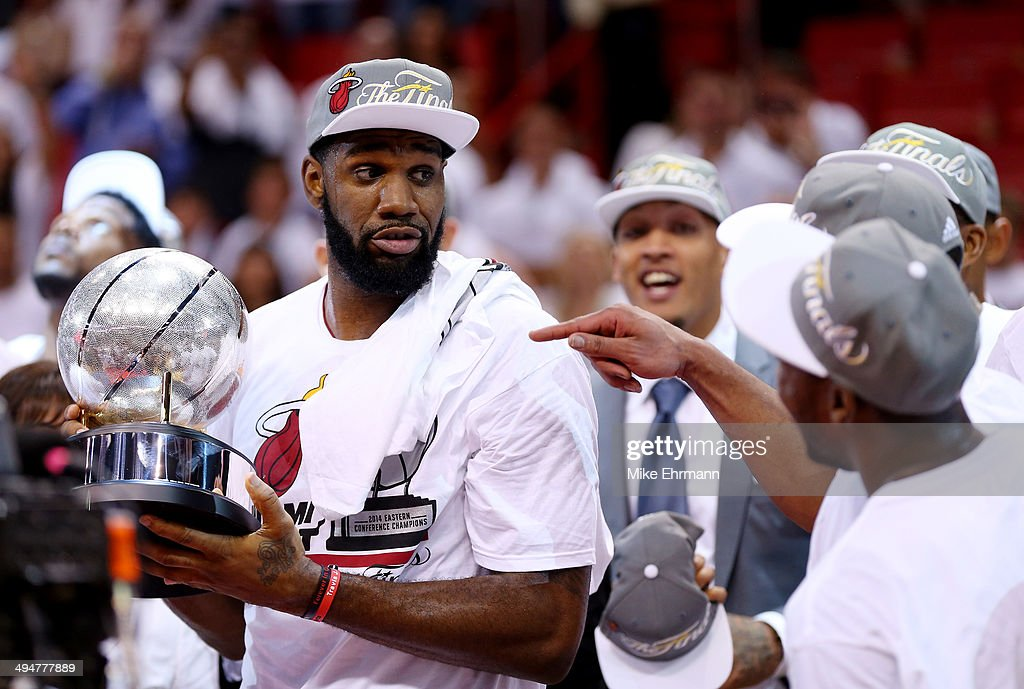 <a gi-track='captionPersonalityLinkClicked' href=/galleries/search?phrase=Greg+Oden&family=editorial&specificpeople=812113 ng-click='$event.stopPropagation()'>Greg Oden</a> #20 of the Miami Heat holds the trophy after defeating the Indiana Pacers in Game Six of the Eastern Conference Finals of the 2014 NBA Playoffs at American Airlines Arena on May 30, 2014 in Miami, Florida.