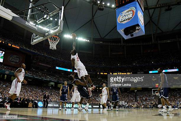 Greg Oden of the Ohio State Buckeyes goes to the hoop against Jeff Green of the Georgetown Hoyas during the National Semifinal game of the NCAA Men's...