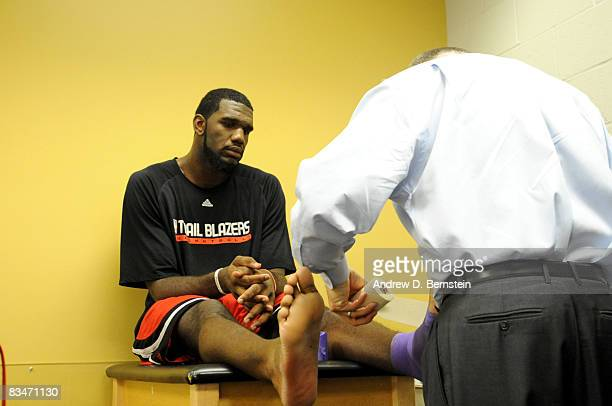 Greg Oden of the Portland Trail Blazers has his ankle taped in the training room before the season opener against the Los Angeles Lakers at Staples...